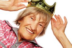 Senior woman wearing crown doing funky action Stock Photography