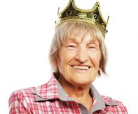 Senior woman wearing crown doing funky action Royalty Free Stock Image