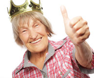 Senior woman wearing crown doing funky action Stock Image