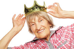 Senior woman wearing crown doing funky action Stock Photos