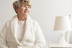 Senior woman wearing dressing gown Royalty Free Stock Image