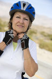 Senior Woman Wearing Helmet Royalty Free Stock Photography