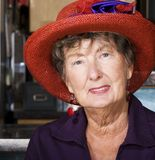 Senior Woman Wearing Red Hat Stock Photos