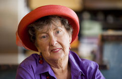Senior Woman Wearing Red Hat Stock Photos