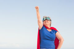 Senior woman wearing superwoman custome Stock Images
