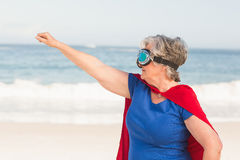 Senior woman wearing superwoman custome. On a sunny day Royalty Free Stock Photos