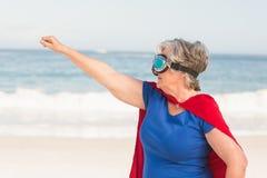 Senior woman wearing superwoman custome