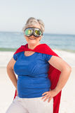 Senior woman wearing superwoman custome Stock Photography