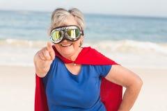 Senior woman wearing superwoman custome. On a sunny day stock photos