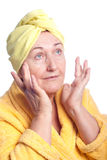 Senior woman wearing yellow towel Stock Image