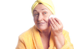 Senior woman wearing yellow towel Royalty Free Stock Photo