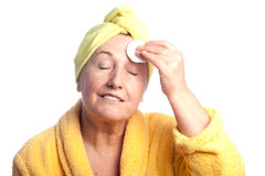 Senior woman wearing yellow towel Royalty Free Stock Image