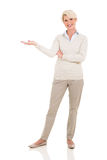 Senior woman welcome gesture Royalty Free Stock Images