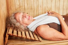 Senior woman is on a wellness vacation. Senior woman makes a spa vacation and relaxes in the sauna royalty free stock images