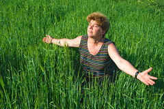 Senior woman in a wheat field Royalty Free Stock Image