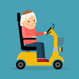 Senior woman on wheel electric scooter Royalty Free Stock Photography