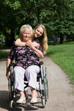 Senior woman in a wheelchair Stock Images