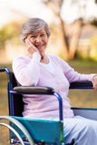 Senior woman wheelchair royalty free stock photography
