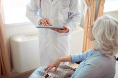 Senior woman in wheelchair with doctor Stock Photos