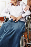 Senior woman in wheelchair getting Royalty Free Stock Photos