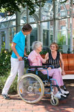Senior woman in a wheelchair with her carer. Royalty Free Stock Photos