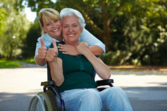 Senior woman in wheelchair holding Royalty Free Stock Photos