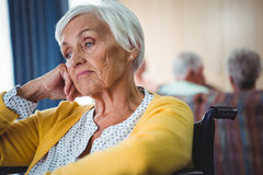 Senior woman in wheelchair look worried Royalty Free Stock Photo