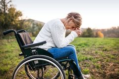 A senior woman in wheelchair in nature. Royalty Free Stock Image