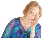 Senior Woman Whispering Royalty Free Stock Photo
