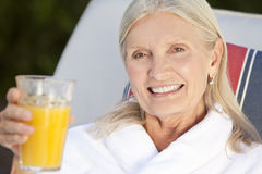Senior Woman in White Bathrobe Stock Images