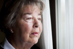 Senior Woman At The Window Stock Images