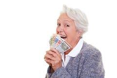 Senior woman winning money Royalty Free Stock Photos