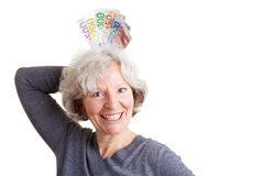 Senior woman winning money Stock Photography