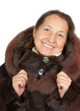 Senior woman in wintry clothes. Portrait of elegant senior lady in fur coat royalty free stock photo