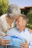 Senior Woman Wishing Man Royalty Free Stock Image