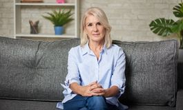 Free Senior Woman With Blue Shirt At Home Stock Images - 158340224