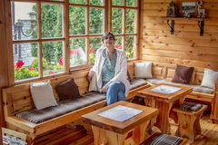 Senior woman in a wooden house royalty free stock photos