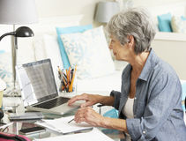 Senior Woman Working In Home Office Royalty Free Stock Photo