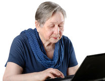 Senior woman working on a laptop Stock Photos
