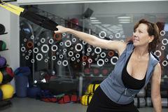 Senior woman working out with trx bands Royalty Free Stock Image