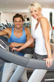 Senior Woman Working With Personal Trainer Royalty Free Stock Image