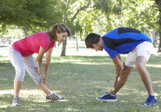 Senior Woman Working With Personal Trainer In Park Royalty Free Stock Photography