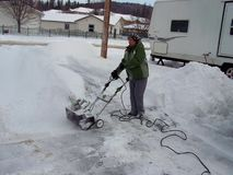Senior Woman Working The Snow Blower Stock Photography