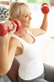 Senior Woman Working With Weights Royalty Free Stock Photos