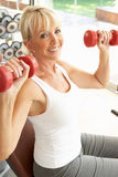 Senior Woman Working With Weights Stock Photos