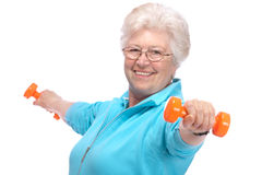 Senior woman working with weights in gym Stock Photography