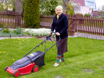 Senior Woman Working With Lawn Mower Stock Image