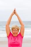 Senior woman workout. Happy senior woman workout on beach Royalty Free Stock Image