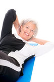 Senior woman at workout. Active senior woman at workout in front of white background Stock Photography