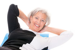 Senior woman at workout. Active senior woman at workout in front of white background Royalty Free Stock Photos
